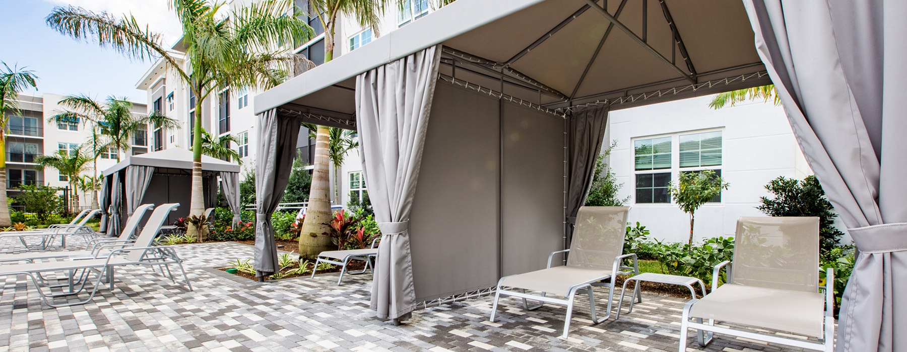 cabanas with lounge chairs
