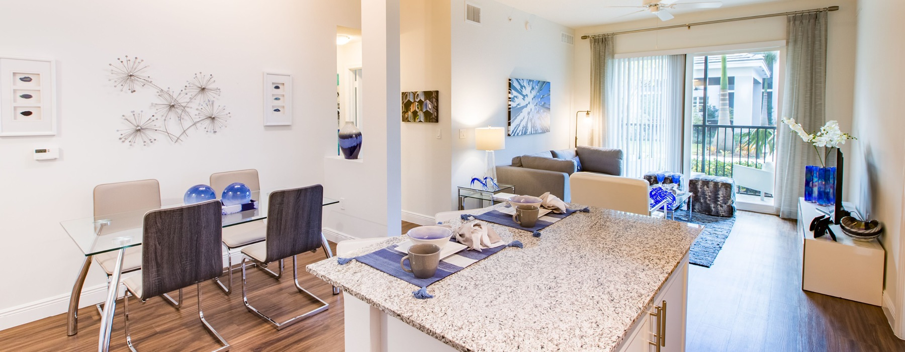 brightly lit and open apartment with private patio